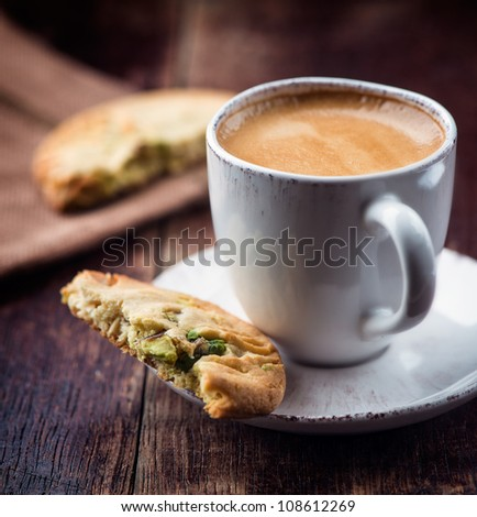 Cup of espresso with pistachio cookie - stock photo