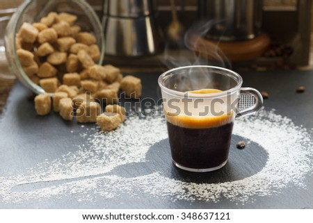 cup of fresh  black coffee espresso  with brown sugar - stock photo
