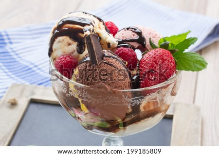 cup of fresh chocolate icecream with berries and chocolate close up - stock photo