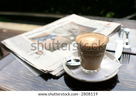 cup of fresh coffee on a table ready for drinking! - stock photo