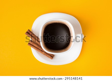 cup of fresh espresso on yellow background, view from above - stock photo
