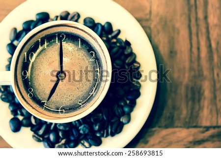 cup of fresh espresso with clock sign, view from above  - stock photo