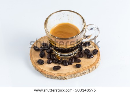 Cup of fresh espresso with coffee bean isolated on white background