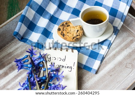 Cup of fresh herbal tea with mint on wooden table - stock photo