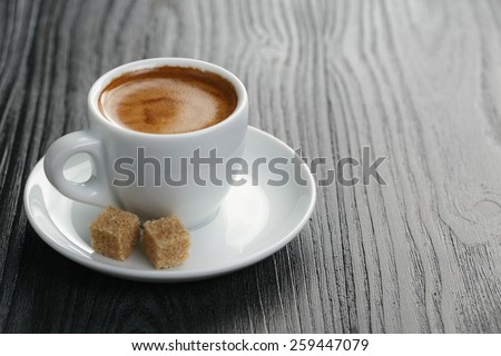 cup of freshly made espresso on wood board - stock photo