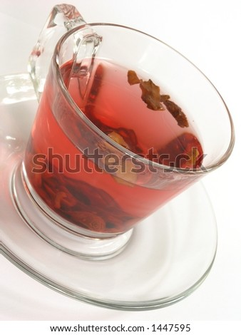 Cup of fruit tea on white background