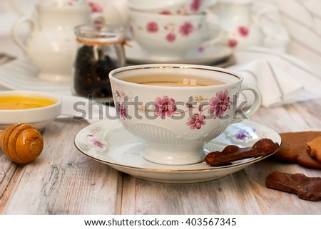 Cup of Ginger tea with lemon and honey on white background,