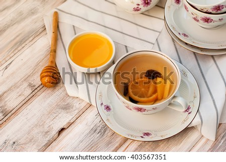 Cup of Ginger tea with lemon and honey on white background, top view - stock photo