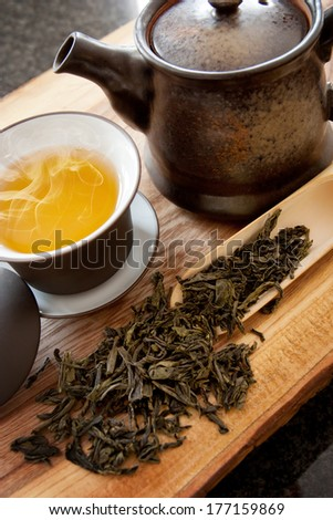 Cup of green tea and accessories - stock photo