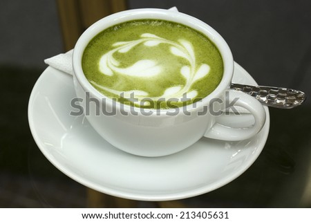cup of green tea latte on the table  - stock photo