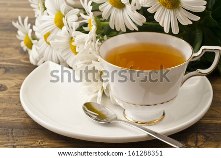 Cup of herbal tea with chamomile flowers