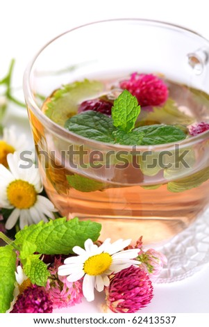 cup of herbal tea with chamomile, mint and clover
