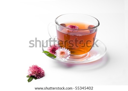 cup of herbal tea with flowers  isolated on white - stock photo