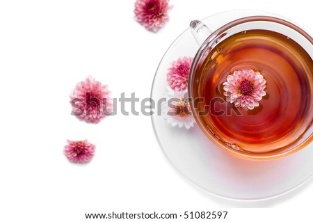 cup of herbal tea with pink flowers - stock photo