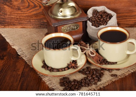 cup of hot black coffee and jug of milk