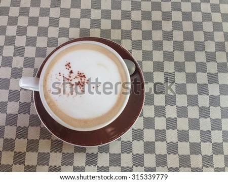 cup of hot cappuccino coffee - stock photo