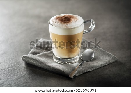 Cup of hot Cappuccino Coffee close up.