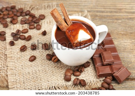 Cup of hot chocolate on table, close up - stock photo