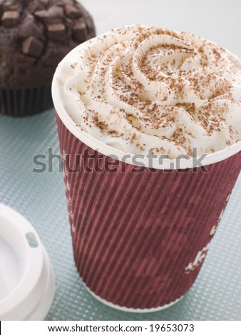 Cup Of Hot Chocolate With A Double Chocolate Muffin - stock photo