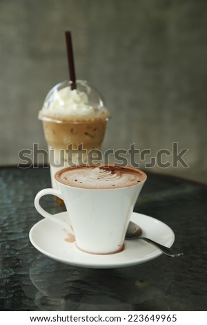 cup of hot chocolate with ice coffee  in cafe - stock photo