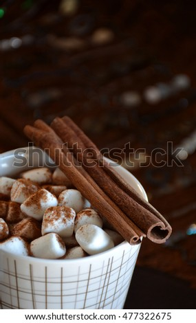 Cup of hot chocolate with marshmallows and cinnamon
