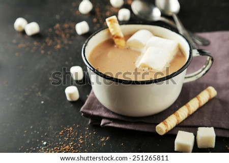 Cup of hot chocolate with marshmallows on black background - stock photo