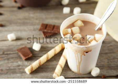 Cup of hot chocolate with marshmallows on grey wooden background - stock photo