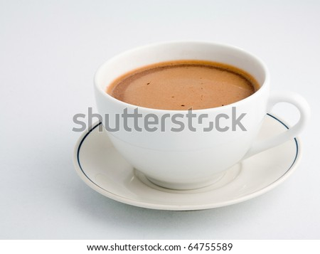 Cup of hot chocolate with saucer on white background