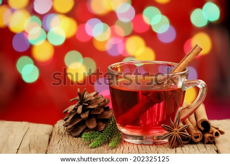 cup of hot christmas drink with cinnamon sticks - stock photo
