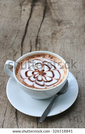 cup of hot cocoa on wood table - stock photo