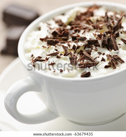 Cup of hot cocoa with shaved chocolate and whipped cream