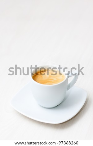 cup of hot coffee on a wooden floor - stock photo