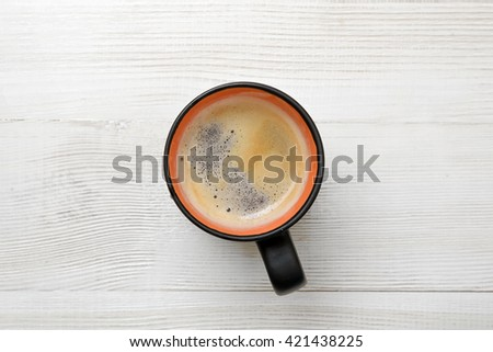 Cup of hot coffee on a wooden surface. Top view. Workplace of office man. Willingness to work overtime. ?onducive working environment. Increasing productivity in the mornings. Improving mood and - stock photo