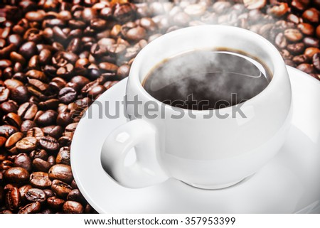 cup of hot coffee on coffee beans roasted
