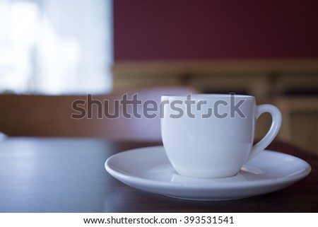 Cup of hot coffee put on the table, Selective focus