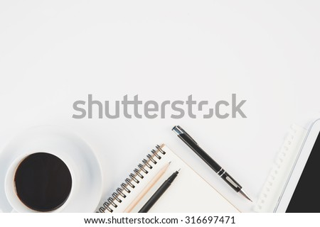 Cup of hot coffee tablet phone and diary notebook on white background for text and background.Copy space - stock photo