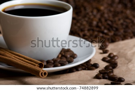 Cup of hot coffee with cinnamon stick. Shadow DOF