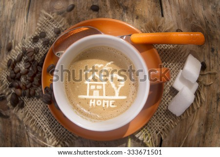 Cup of hot coffee with represented my little house - stock photo