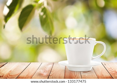 Cup of hot drink on summer background, free space for text - stock photo