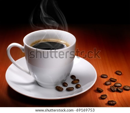 Cup of hot drink with coffee beam's - stock photo