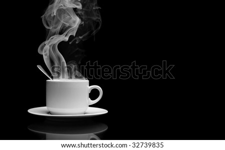 Cup of hot drink with steam over black background - stock photo