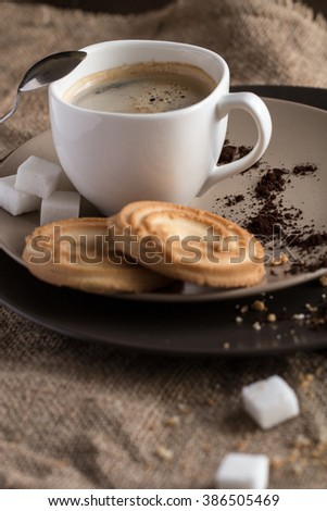 cup of hot espresso coffee, and cookie