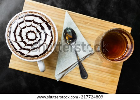 Cup of hot latte coffee - stock photo