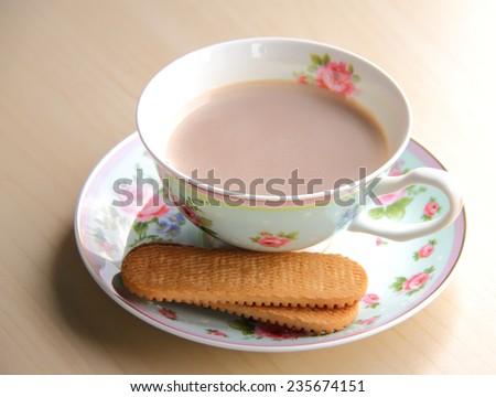 Cup of hot milk tea - stock photo