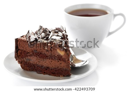 Cup of hot tea and homemade cake on white background - stock photo