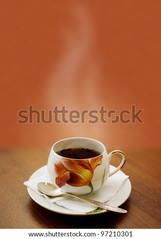 cup of hot tea on a brown background - stock photo
