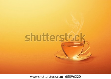 Cup of hot tea on a yellow background - stock photo