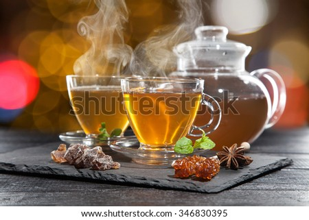 Cup of hot tea on dark background - stock photo