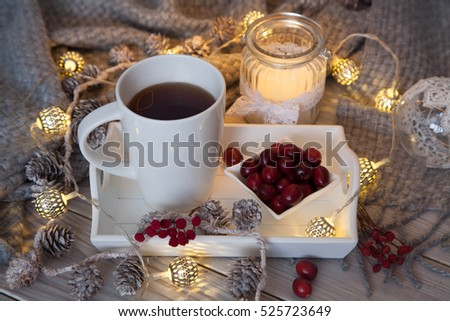 Cup of hot tea on wooden table