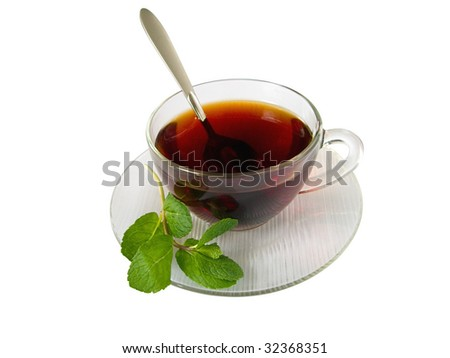 cup of hot tea with aromatic spearmint - stock photo